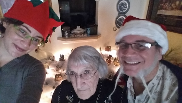 Eula, Doug, and Megan in front of Mom's Christmas Village, 2016